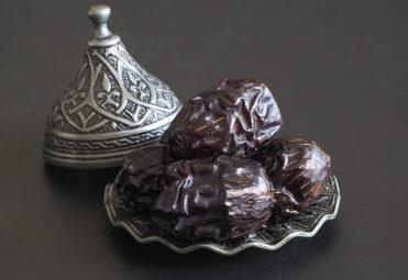 Dates on a plate. Minimalistic Ramadan food background.