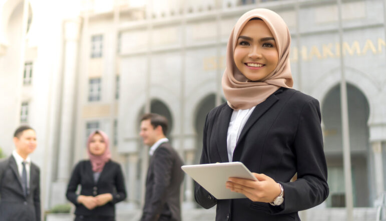 Young,Asian,Malay,Girl,Wearing,Suit,Holding,Tablet,Computer,And