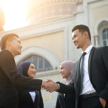 Malay,Muslim,Business,Team,Handshaking,During,Meeting